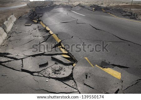 cracked asphalt after earthquake Royalty-Free Stock Photo #139550174