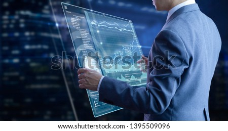Businessman holding a modern tablet touch screen analysing on investment risk managment and return on investment analysis #1395509096