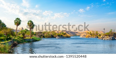 River Nile and boats at sunset in Aswan #1395520448