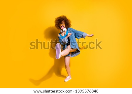 Full length body size photo funny she her lady wavy styling curls clubber strange moves wear headset ear flaps specs casual jeans denim shirt shorts tank top clothes isolated yellow background #1395576848