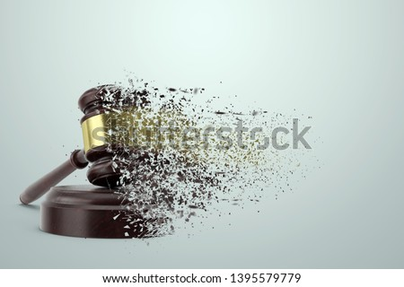 Judge's hammer scatters in the dust on a light background. The concept of corrupt court, unfair trial, helplessness. copy space