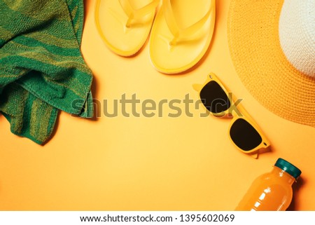 Summer beach accessories flat lay top view with copy space, warm toned image of straw hat and sunglasses with other objects for summertime vacation holiday #1395602069