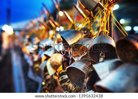 Hanging bells, leaves, are donated to the buddhist  temples  as the raw material to make buddha images. Thailand, Myanmar, Laos. #1395632438