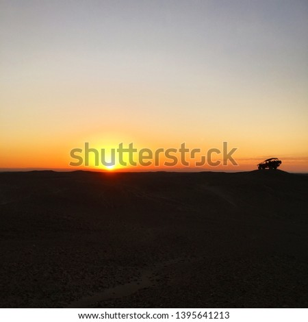 A Dune Buggy Silhouette In The Desert At Sunset. #1395641213