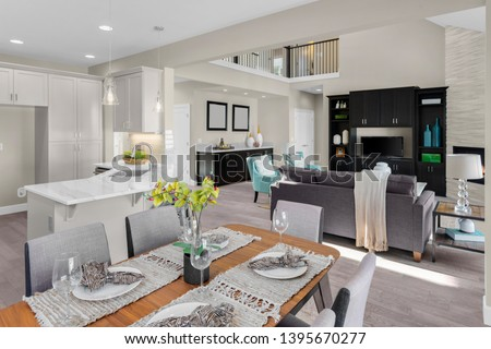Beautiful Kitchen, Dining Room, and Living Room in New Home with Open Concept Floor Plan #1395670277