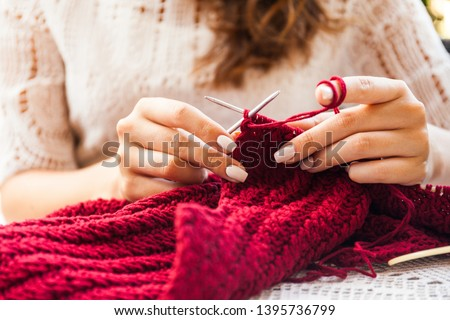 I can create anywhere. Woman knitting on terrace with a cup of coffee. #1395736799