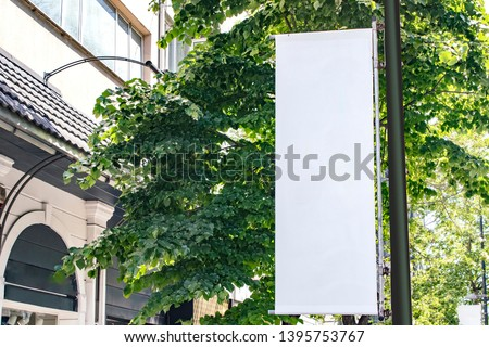 billboard mockup outdoors, lamp post banner exterior templates advertising poster at day time with street light line for advertisement street signboard . With clipping path on screen
