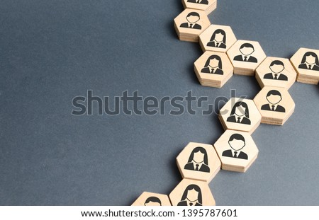 Symbols of employees on the chains of hexagons. The concept of business connections. Team building, business organization and staff hierarchy. Human resources management, recruitment. Single whole. #1395787601