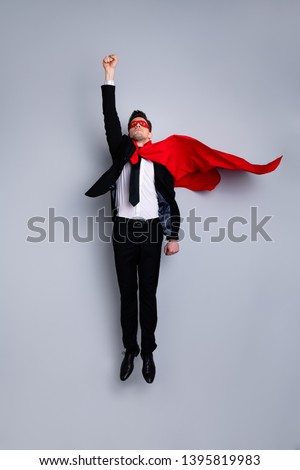 Full length body size photo jumping high he his him I save world expression costume flight up fist raised superman pose mood wear formal wear white shirt suit jacket tie isolated grey background #1395819983