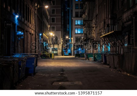 Chicago downtown alley at night Royalty-Free Stock Photo #1395871157