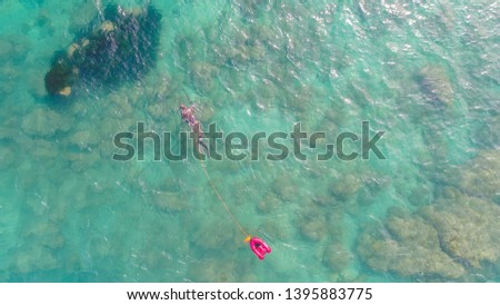 air view of spearfishing in sea with small rib  #1395883775