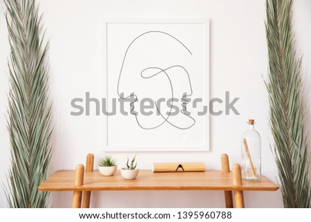 Stylish korean interior of living room with white mock up poster frame, elegant accessories, wooden shelf and tropical palm leafs. Minimalistic concept of home decor. Template. Bright room. #1395960788