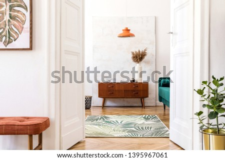 Stylish compositon of retro home interior with mock up poster frame, vintage furnitures, velvet sofa, design lamps, plants in gold pot  and elegant accessories. Nice home decor of living rooms.  #1395967061