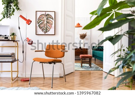 Stylish compositon of retro home interior with mock up poster frame, vintage furnitures, velvet sofa, design lamps, gold shelf, plants and elegant accessories. Nice home decor of living rooms.  #1395967082