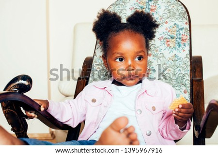 little cute african american girl playing with animal toys at home, pretty adorable princess in interior happy smiling, lifestyle people concept close up #1395967916