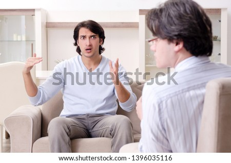 Young male patient discussing with psychologist personal problem #1396035116