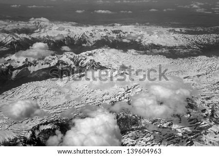 The view from the airplane window at the beautiful weather with clouds and mountains #139604963