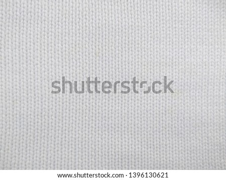 Knitted clothes from wool yarn. Background of wool yarn for yarn frame. White knitting yarn for handicrafts background. #1396130621