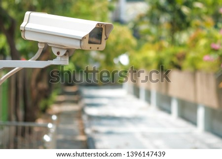 CCTV camera on a wall. A blurred night cityscape background. lungs separated. #1396147439