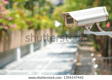 CCTV camera on a wall. A blurred night cityscape background. lungs separated. #1396147442