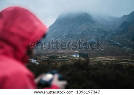 Female photographer at Glen Etive, Scotland