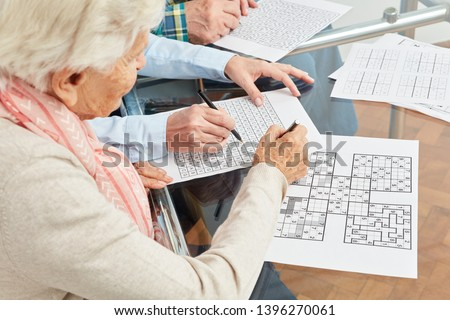 Old woman solves sudoku puzzles as memory training #1396270061