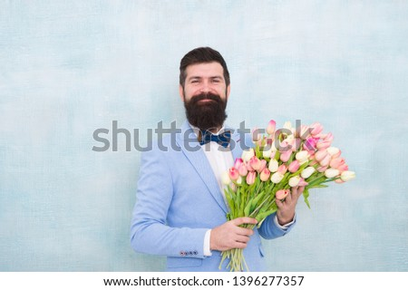 bearded man in bow tie with tulip flowers. bride groom at wedding party. spring bouquet. 8 of march. love date with flowers. Happy Birthday. womens day. Formal mature businessman. Forever young. #1396277357