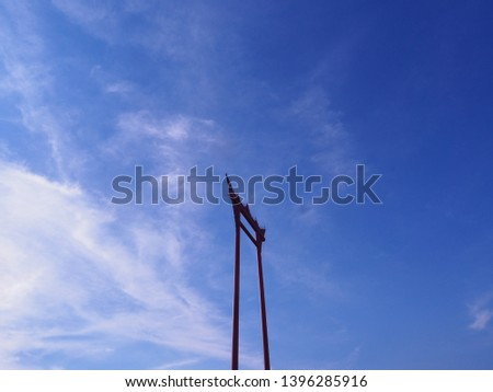 The giant swing in red with a bright blue sky. Bangkok landmark Swing Pole (Sao ching cha) #1396285916