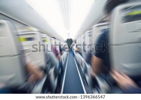 aerophobias concept. plane shakes during turbulence flying air hole. Blur image commercial plane moving fast downwards. Fear of flying. collapse slump, depression, downfall, debacle, subsidence. dive #1396366547