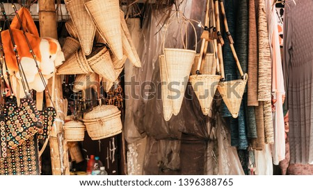 Meghalaya handicrafts art and crafts made with cane and bamboo products. Bamboo Cane work, Stools, Baskets, fishing traps, containers for display in Handloom and Handicraft Market in Meghalaya.