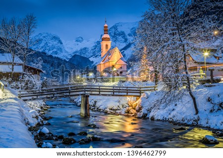 Beautiful twilight view of Sankt Sebastian pilgrimage church with decorated Christmas tree illuminated during blue hour at dusk in winter, Ramsau, Nationalpark Berchtesgadener Land, Bavaria, Germany #1396462799