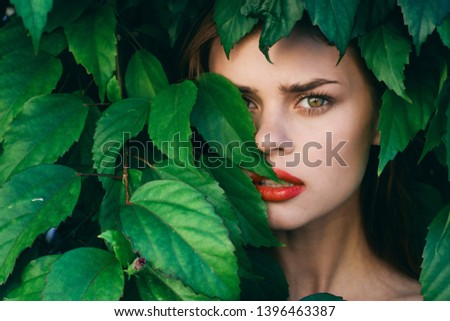 beautiful woman with make-up on face exotica green shrub nature model cosmetology #1396463387