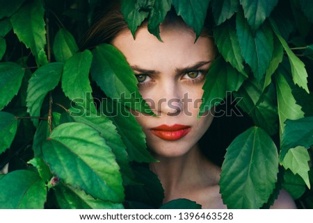 beautiful woman with make-up on face exotica green shrub nature model cosmetology #1396463528