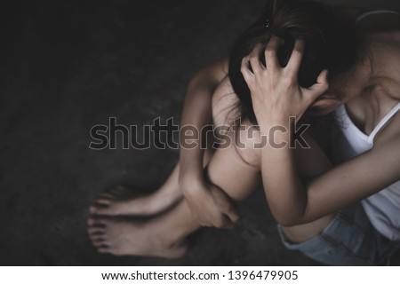 Young depressed woman, domestic and rape violence,beaten and raped sitting in the corner, Domestic violence. Copy space. #1396479905