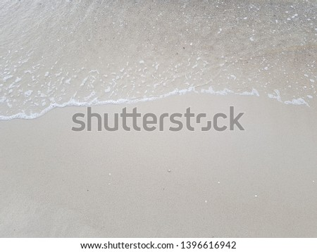 the wave slowly fade in sandy Beach  #1396616942