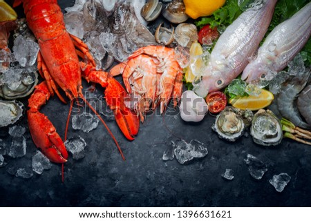 Shellfish and crustacean seafood with selection of fresh lobster, shrimp, fish, oyster, squid and crab on wooden background. #1396631621
