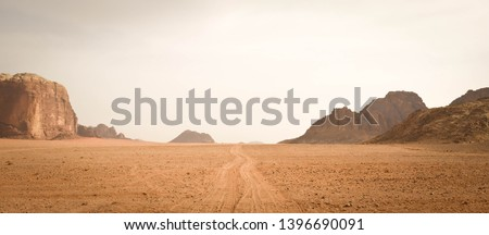 Landscape view of dusty road going far away nowhere in Wadi Rum desert, Jordan #1396690091