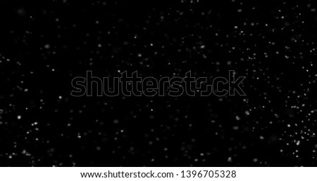 Flying dust particles on a black background #1396705328