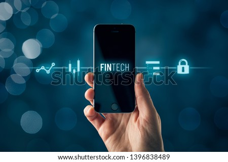 Fintech (financial technology) on smart phone concept. Hand with smart phone and text fintech and financial icons. #1396838489