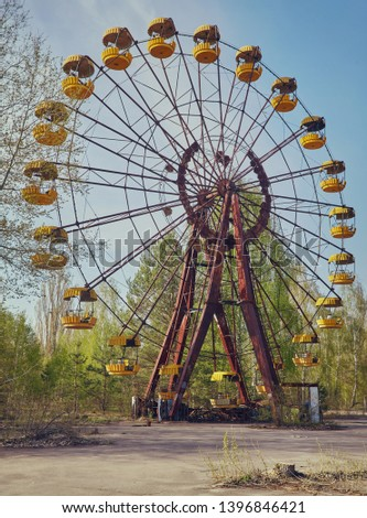 The abandoned Ferris wheel in the amusement park in Pripyat. Chernobyl nuclear power plant zone of alienation #1396846421
