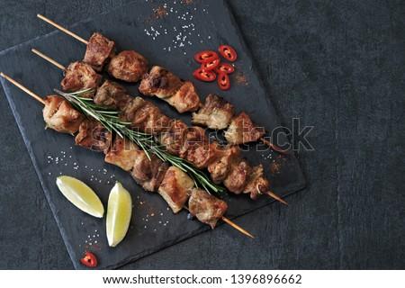 Appetizing kebab on wooden sticks. Keto Paleo. Pegan Diet. #1396896662