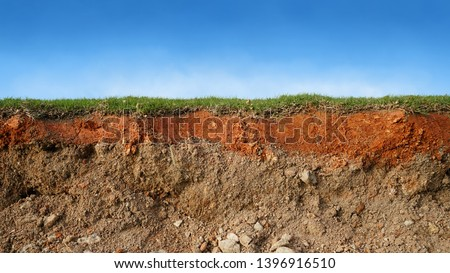 underground soil layer of cross section earth, erosion ground with grass on top #1396916510