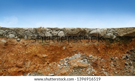 underground soil layer of cross section earth, erosion ground with concrete on top #1396916519