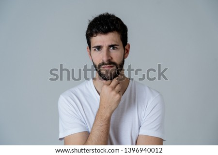 Close up of a creative young bearded caucasian man thinking in new ideas looking up wondering. In people Entrepreneur Positive human facial expressions and emotions. Gray background #1396940012