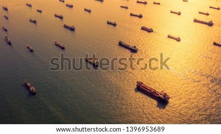 Aerial view oil and gas petrochemical tanker offshore in open sea, Refinery industry cargo ship, Oil product tanker and LPG tanker at sea view from above, Aerial view oil tanker ship at sunset. #1396953689