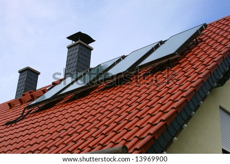 solar cells on a roof #13969900