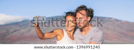 Happy couple tourists smiling taking photo with phone. Mobile smartphone selfie picture of lovers on adventure holiday trip. Travel in Europe banner panorama. Summer lifestyle.