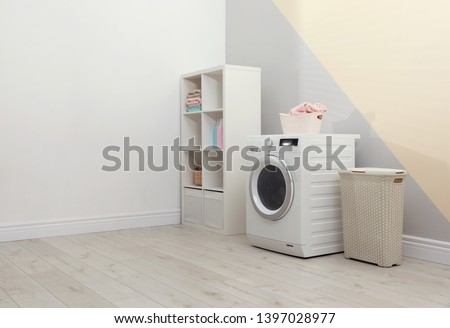 Modern washing machine in laundry room interior. Space for design #1397028977