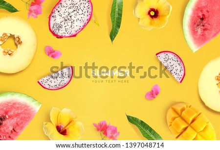 Creative layout made of melon, watermelon, dragon fruit, mango and flowers on yellow background.  Tropical flat lay. Summer fruits concept.  #1397048714