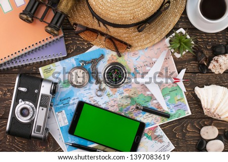 items and accessories for the traveler on the old background on the table #1397083619